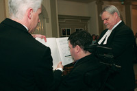 Fletcher signing at his swearing in