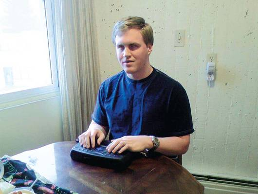 Lorne Webber uses his PAC Mate, a computer for people with vision disabilities