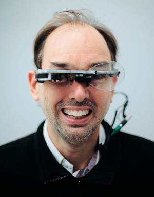 Steve Mann wearing Eye-Tap computerized eyeglasses.
